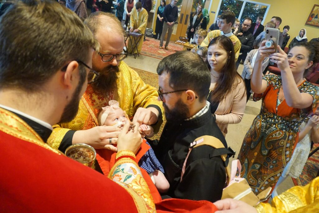 Chrismation of a baby girl recovering from her first heart surgery at Holy Apostles Church in Mechanicsburg, PA.